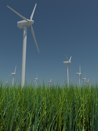 windless: Several windmills standing in the field with grass against the blue sky a bright sunny, windless summer day