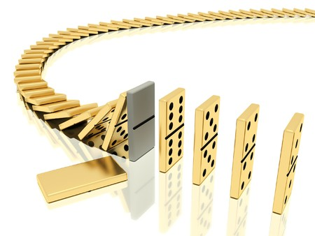 domino effect: On a image  is shown golden domino bones on a white background  in action of  dominoes effect which was halted with help of particular domino bone placed instead of the usual which lies close