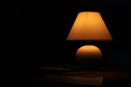 lamp shade: Ancient lamp on table in the dark