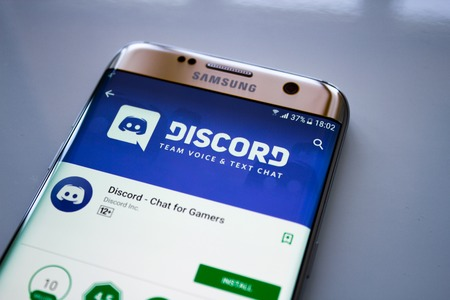 Kazan, Russian Federation - Jun 15, 2018: Discord mobile app on the display of tablet PC.