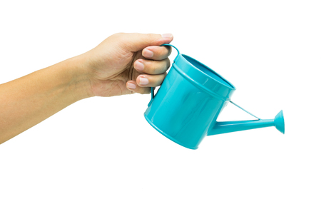 hand with blue watering can isolated on white background