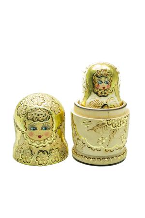 matryoshka doll: A gold matryoshka doll (Russian Doll) isolated on white Stock Photo