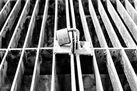 sense of security: close up of rusty lock in black and white concept security and protection Stock Photo