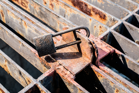 sense of security: close up of rusty lock concept security and protection Stock Photo