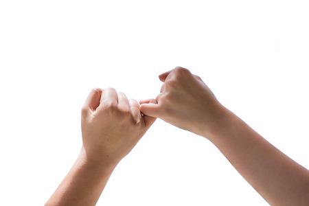 dedo meÑique: El hombre y la mujer que hace una promesa del meñique aislados sobre fondo blanco Foto de archivo