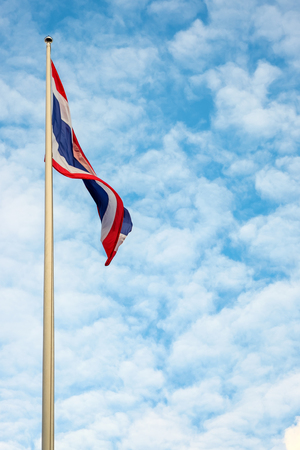 ethnical: flag of Thailand with blue sky background.