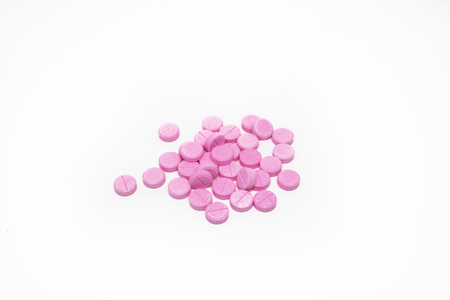 Pink Pills isolated on white background.