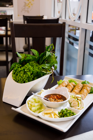Grilled pork with vegetables and wrapping flour. Vietnamese style food Archivio Fotografico