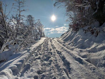 Winter landscape with mountain and sun in village of Parva Transylvania Romania
