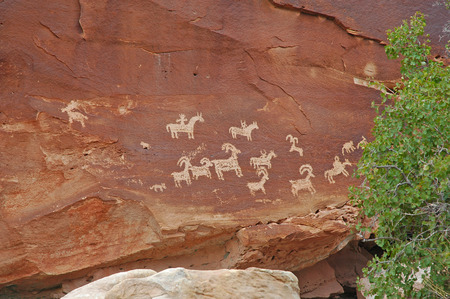 Petroglyphs in Red Rock landscape, Southwest USA photo