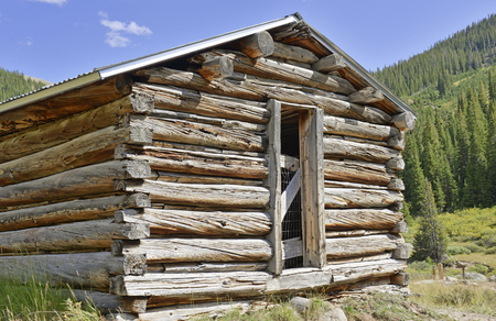 log cabin: Old log cabin in abandoned mining town, Western USA Stock Photo