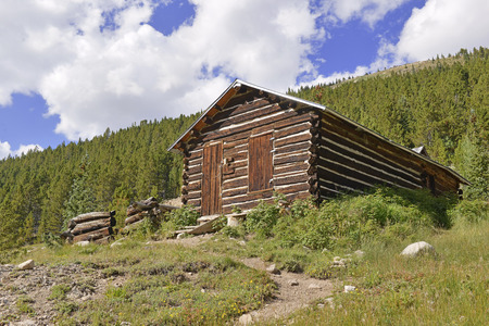 log cabin: Vintage log cabin in old mining town Stock Photo