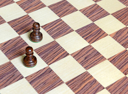 chess board: Wood Chess pieces on Rosewood chess board