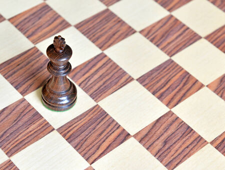 Wood Chess piece on Rosewood chess board photo