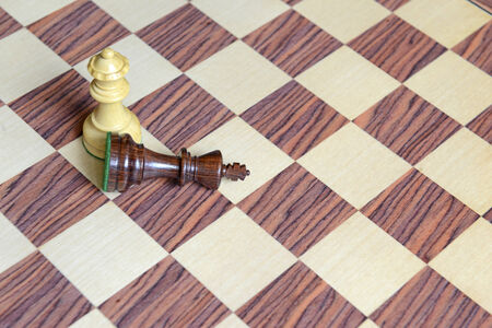 Wood Chess pieces on Rosewood chess board photo