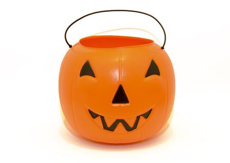 トリックのハロウィンかぼちゃお菓子バケツ 写真素材