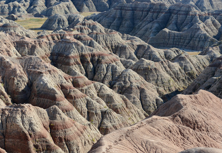 Badlands landscape, formed by deposition and erosion by wind and water, contains some of the richest fossil beds in the world, Badlands National Park, South Dakota, USA Imagens