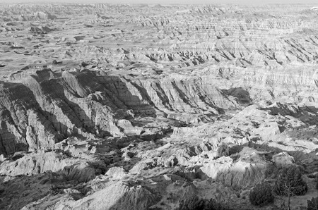 mesas: Badlands landscape, formed by deposition and erosion by wind and water, contains some of the richest fossil beds in the world, Badlands National Park, South Dakota, USA Stock Photo