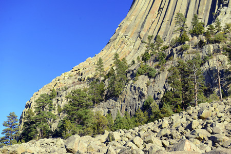 Devils Tower National Monument, a geological landform rising from the grasslands of Wyoming, is a popular tourist attraction, source for Native American legend and rock climbing goal for climbers