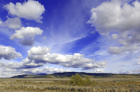 wild prairie: Blue sky with clouds over the Rocky Mountains