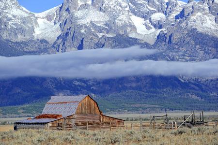 cloud capped: Barn and Grand Teton and the Teton Range, Grand Teton National Park, Wyoming, USA