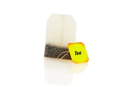 Bag of black tea isolated on white background