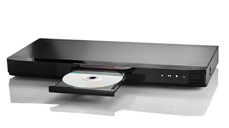 bluray: Blue Ray player with a disk on a white background closeup
