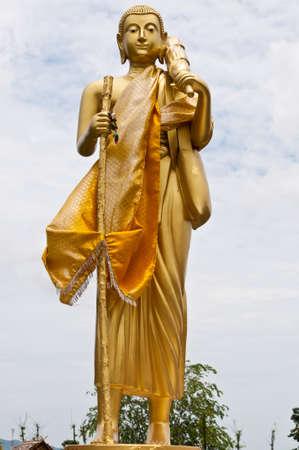 pilgrimage: Golden monk on pilgrimage statue