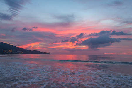 Pink sunset on the Andaman sea, Kamala beach, Phuket, Thailand