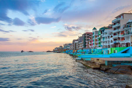 Embankment in the Utes city, Crimea in at sunset. Colorful houses are close to each other, beautiful scenery