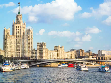 View on Moskva river, Big Ust'insky bridge, Kotelnicheskaya embankment and Kotelnicheskaya high-rise, summer Moscow cityscape