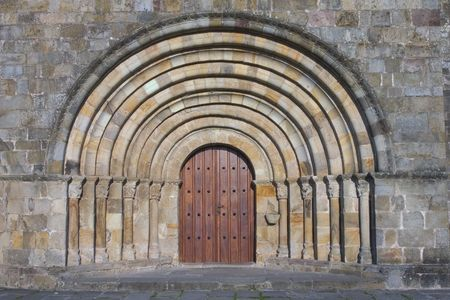simetry: Door in a monumental church Stock Photo
