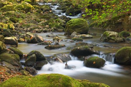 long exposure in a river in a sunny day of autumn photo