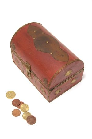 wood chest with golden ornaments and a few coins  isolated white background photo