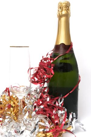 champagne bottle and a glass with multicolored strips on celebration photo