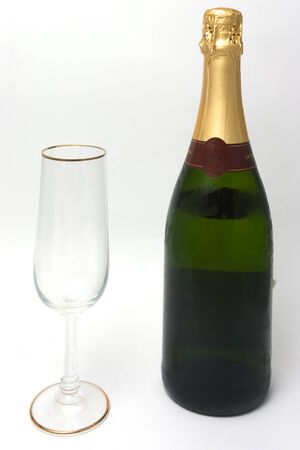 champagne bottle and a glass isolated on white background photo