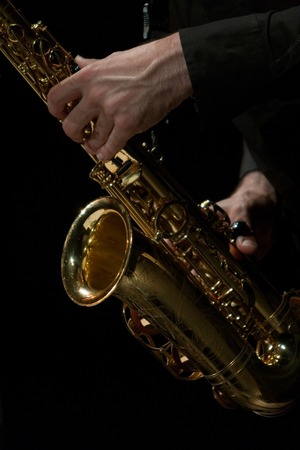 A sax player isolated in black background Stock Photo - 1533733