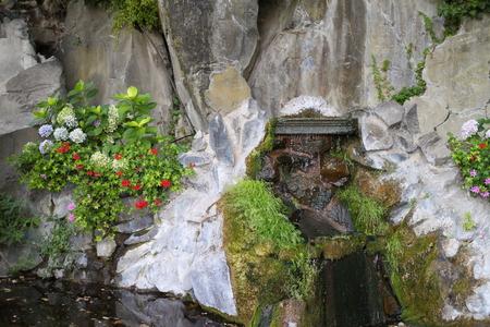 italian fountain: Old stone fountain in an Italian village. Stock Photo