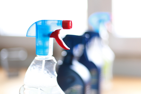 Spray bottle of disinfectant household cleaners. Stock Photo