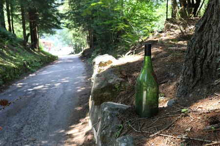 Bottle of wine from the road through the woods of Trentino Alto Adige, Italy
