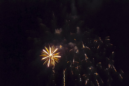 Festive salute in the night sky. Explosions of fireworks. Stock Photo