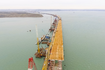 Construction of the bridge. Engineering facilities for the construction of a railway and automobile bridge across the strait. Zdjęcie Seryjne