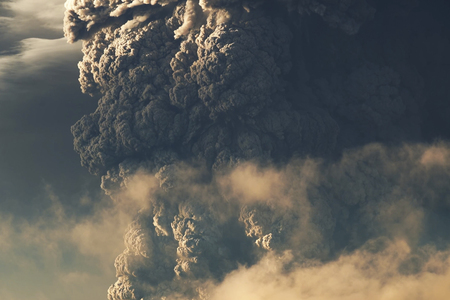 Eruption. Clubs of smoke and ash in the atmosphere.