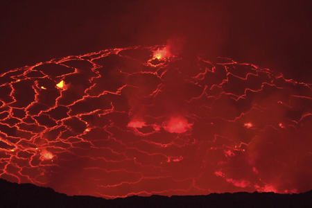 Mouth of the volcano with magma. Molten magma in the muzzle. Stock Photo