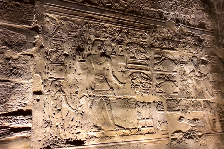 Egyptian hieroglyphs and drawings on the walls and columns. Egyptian language, The life of ancient gods and people in hieroglyphics and drawings