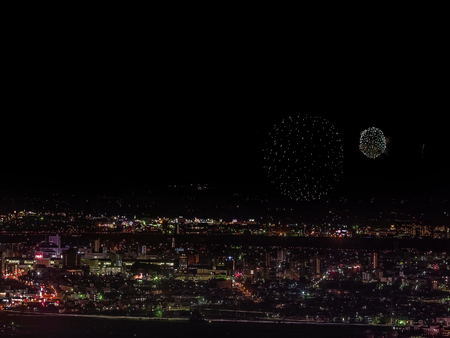Festive salute in the night sky. Salute over the city the megalopolis. Explosions of fireworks. Imagens