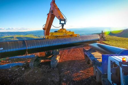 Construction of the pipeline. Site construction. Construction machinery Фото со стока