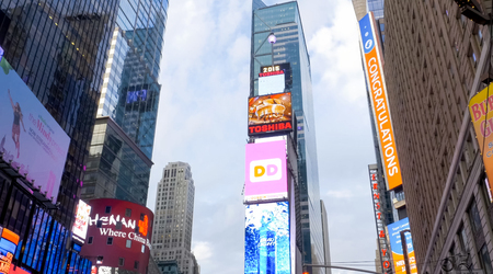 New York, USA - June 20, 2015: Walking through the streets of New York, Manhattan. The life of New York in the afternoon. Streets and city buildings.