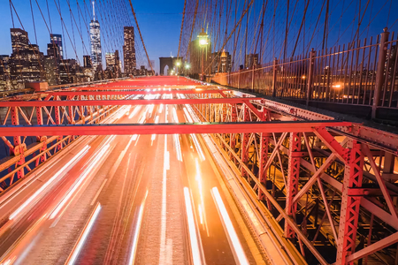 Night lights of car headlamps on the Brooklyn bridge. Long exposure.