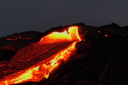 Pouring lava on the slope of the volcano. Volcanic eruption and magma